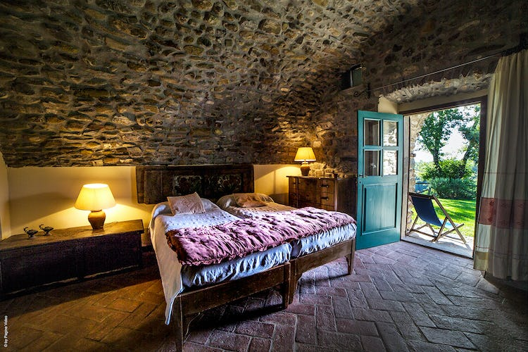 Agriturismo Ca' del Bosco - stone arches and french doors to the garden