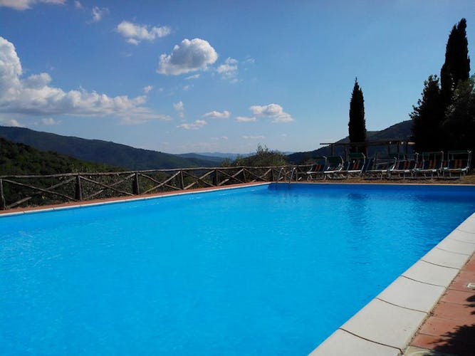 The enchanting pool with a view over the countryside