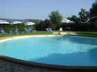 The huge outdoor pool surrounded by the garden