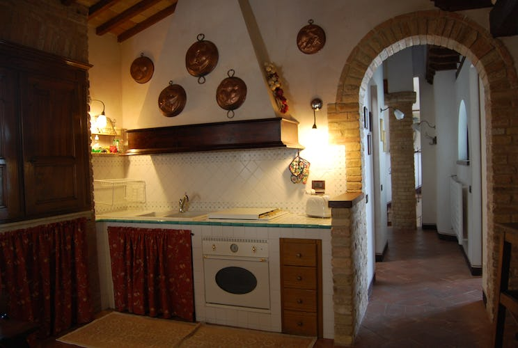 Tuscan style kitchen at the Attico Duomo apartment in San Gimignano