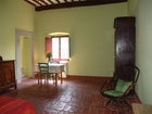 The green colourewd bedroom, furnished in typical Tuscan style