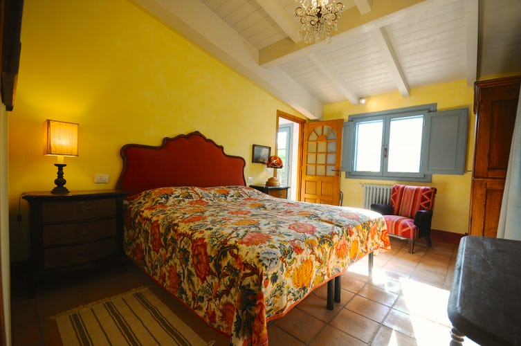One of the two bedrooms in this charming Chianti apartment