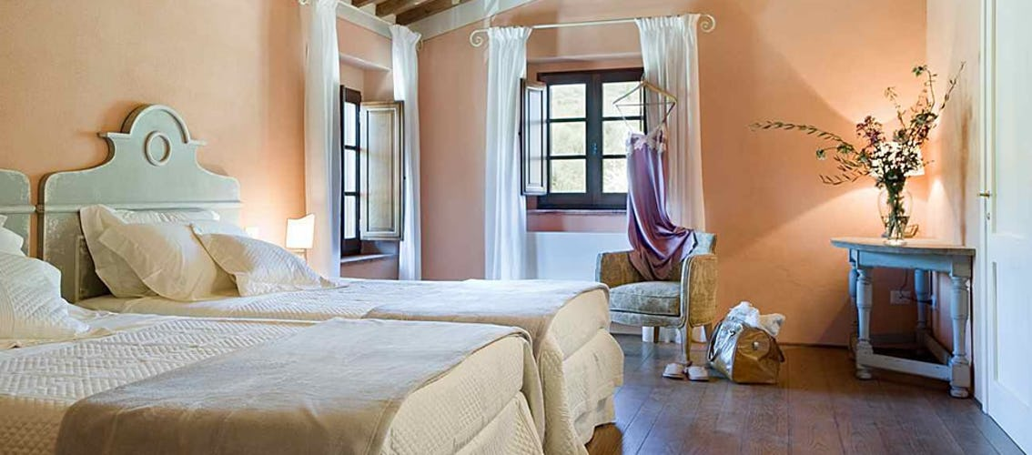 I colori chiari delle camere, come quelli utilizzati per decorare Lavanda, donano ulteriore luminosità agli ambienti