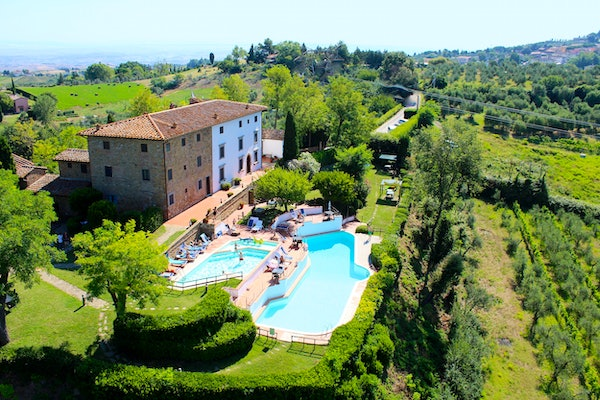 View of Borgo La Casaccia from above, with its gardens and two pools