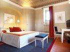 Dettagli raffinati ed elementi tradizionali caratterizzano le camere