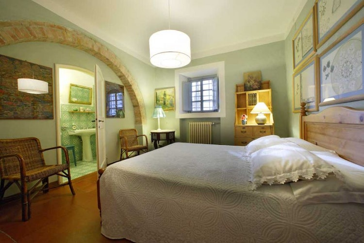 Nary's bedroom is on the ground floor of Candida's Chianti House