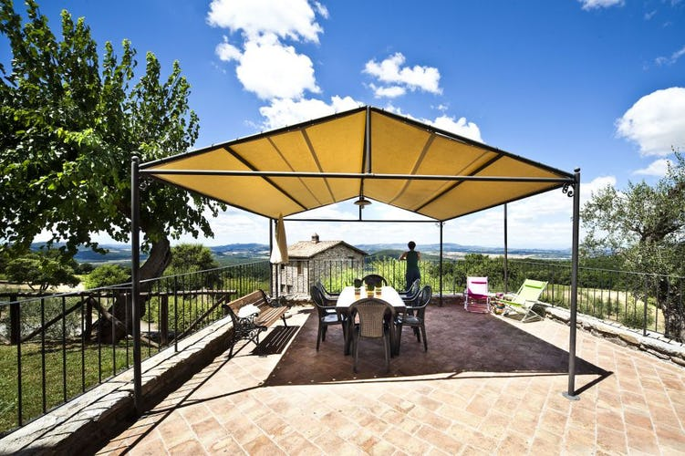 Every apartment has a covered eating area at Podere Ripostena