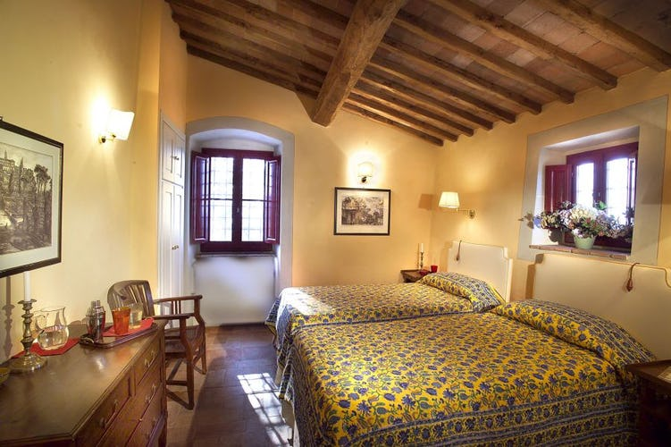 Spacious bedrooms with lots of natural light at Chianti Suites