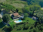 Surrounded by the green of the Tuscany mountains
