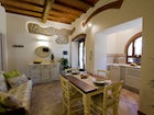 Kitchen and dining room in typical Tuscan rural style