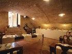 The antique cellar with the breakfast buffet  at il Chiostro del Carmi