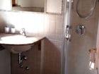 Modern bathroom with shower, bidet, sink and WC