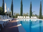 Refreshing pool surrounded by typical Tuscan Cypress trees