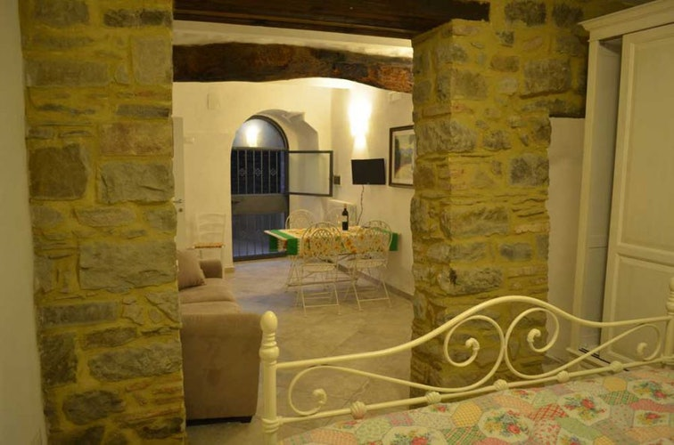 the bedroom on the bottom floor has a quaint little courtyard
