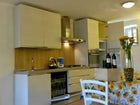 Fully equipped kitchen including oven and dishwasher