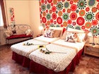 Two bedrooms are furnished with two single beds at Mamii Haus