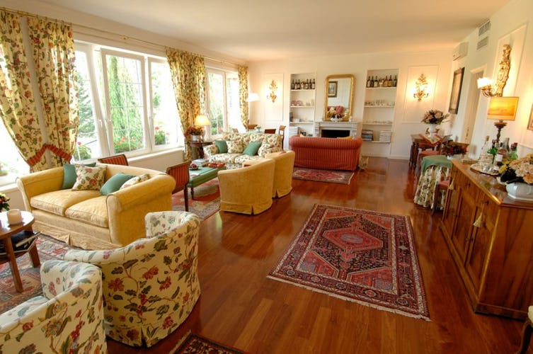 The comfortable living room with warm parquet floors
