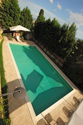 Relax at the private pool area at il Chiostro di Pienza