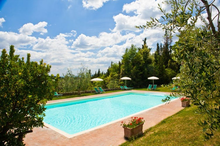 Pool with view in Tuscan farmhouse