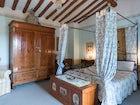 Villa Lysis - letto a baldacchino in ferro battuto