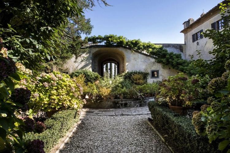 Lush green garden inside the courtyard of Villa Medicea Lilliano