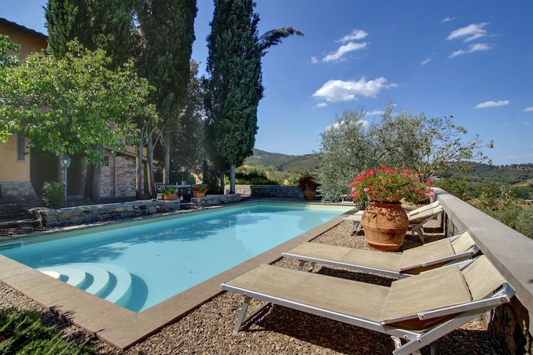 Deluxe swiming pool with loungre chairs at Villa Stolli