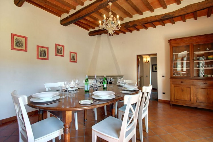 Enjoy meals together in the dining room with fireplace at Villa Stolli