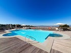 A panoramic vista poolside from Villa Tolomei Hotel & Resort